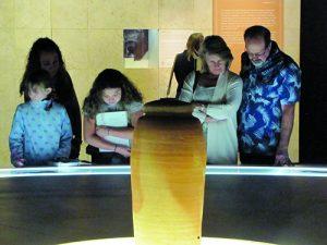 Visitors of U.S museum with original clay jar