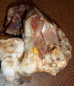 Brown and red staining on Data Creek quartz crystal