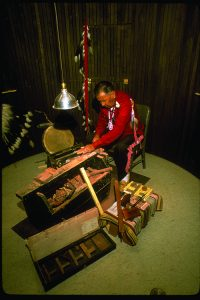 Native American craftsman working with pipestone