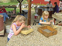 Children finding garnets at Red Rock Mine
