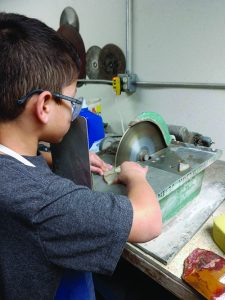 Theo at a lapidary machine