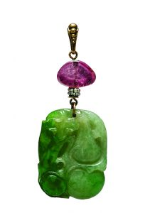 Carved jadeite pendant with gold, seed pearls, and amethyst