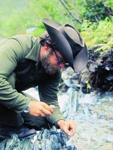 Steve Voynick picking gold nuggets
